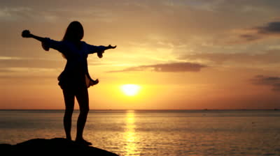 stock-footage-happy-woman-dancing-on-the-beach-at-