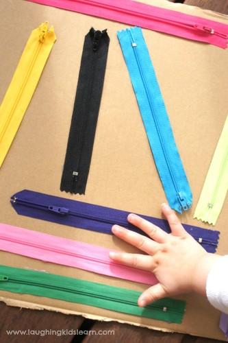 playing-with-a-handmade-sensory-board-using-zipper