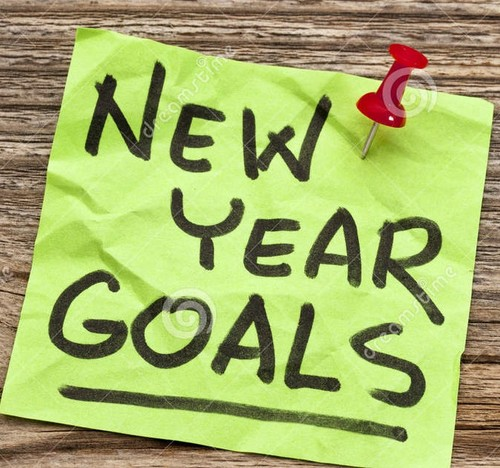 new-year-goals-handwriting-sticky-note-against-gra